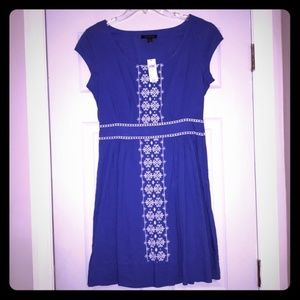 Blue dress with white embroidery